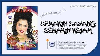 Download Rita Sugiarto -  Semakin Sayang Semakin Kejam (Official Music Video)