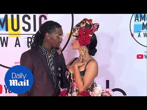 Look of love! Cardi B hits the AMAs red carpet with Offset