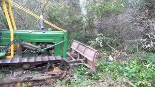 JOHN DEERE CRAWLER 420C TAKING DOWN OLIVE TREES