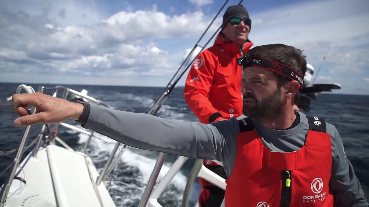MAPFRE in their wake. Charles: After this mark we go upwind. Charles driving. Carolijn trimming. Stu: Where's this mark?.. What's the bearing... 214? Pascal comes up and looks around. Charles: Can we go up? Pascal answers in French. Jack on the foredeck. So far I've had two lots of 3 and a half minutes (sleep). Went downstairs at one point last night and got about 3 minutes before I got called up. Won't be a chance for sleep for some time. Going into Aarhus; lots of maneuvers. Maybe on our way up to Norway again, we'll get a chance to chill out a bit. But I don't think so.