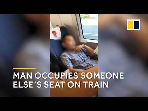 Man occupies someone else's seat on train in China