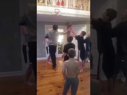 Boys playing basketball in foyer