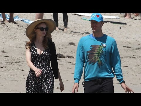 Chris Martin Takes a Sandy Beach Stoll with Heather Graham -- See The Pic!