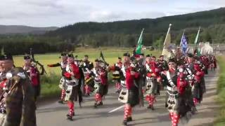 2016 Lonach and Atholl Highlanders march through Strathdon in the Cairngorms Scotland
