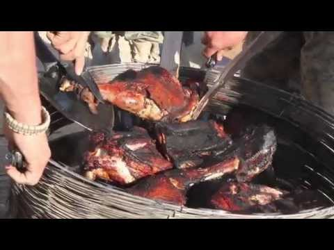 US Marines cook a meal of Lamb in Sangin Afghanistan 2010
