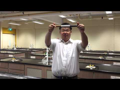 A Thermal Physics Experiment: Heat Conduction with Copper and Wood