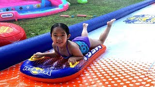Queenie Fun Playing with Inflatable Mega Slide | Fun Outdoor Playground for kids