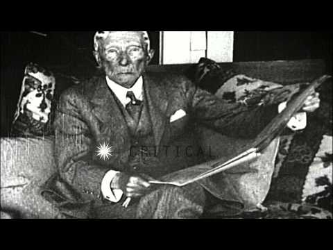 John D. Rockefeller reads a newspaper and plays golf ...HD Stock Footage