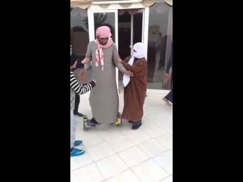 Arab old man falling from skate board