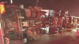 Log truck overturns on Hwy 601