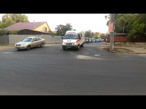 Gazelle ambulance responding with siren and LED green lights
