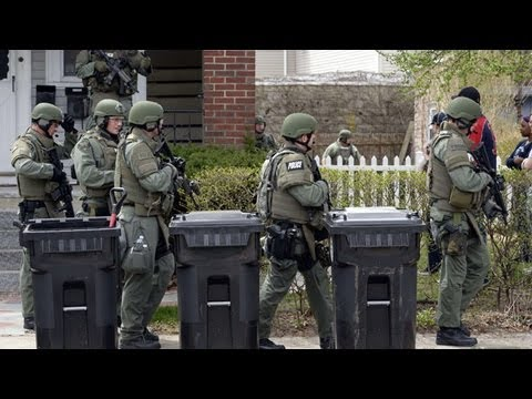 Boston manhunt: father claims suspects were framed as search continued