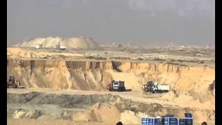 Suez Canal new: a scene in the dig on Sept. 21, and hundreds of cars, loaders