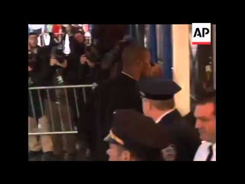 New York Giants wide receiver Plaxico Burress arrived at a New York police station early Monday morn