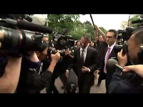 Nigel Wright arrives at court and makes way through crush of media