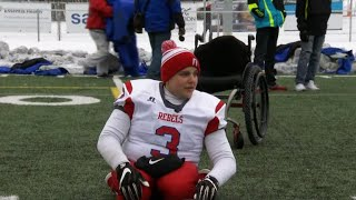 A football player unrestrained by his wheelchair