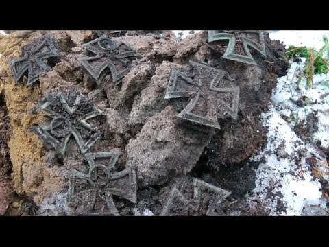 Metal detecting a hoard again - this time iron crosses - Liv