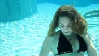 Alyssa Beth Kahn untying her bikini underwater