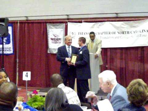 Dan Tomchik receiving Don Mccauley Scholar-athlete award