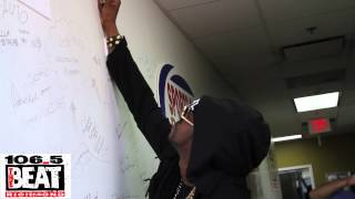 2 Chainz signs 106.5 The Beat Wall