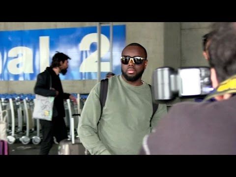 EXCLUSIVE: Maitre Gims and his wife arriving at Cannes airport for the festival