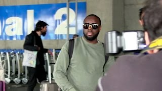 exclusive maitre gims and his wife arriving at cannes airport for the festival