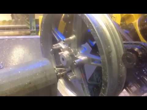 Robotic System for Deburring & Milling Motorcycle Wheels – Acme Manufacturing