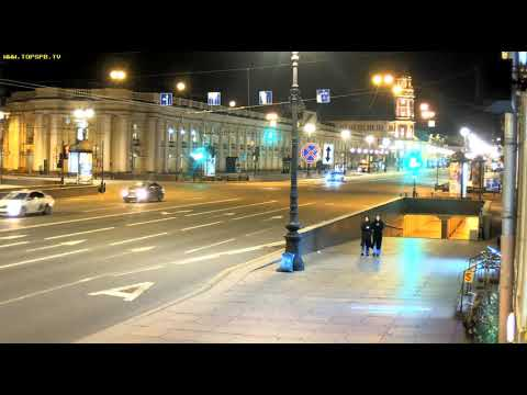 Two sisters.Nevskiy Pr. at night, St. Petersburg, Russia