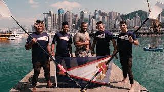 American Samoan athletes perform the Siva Tau