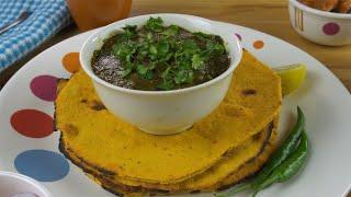 Tilt shot of freshly made Makki Ki Roti and Sarson ka saag - Indian food concept