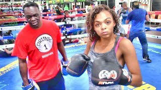 Jeff Mayweather holding pads for talented amateur Czarina McCoy