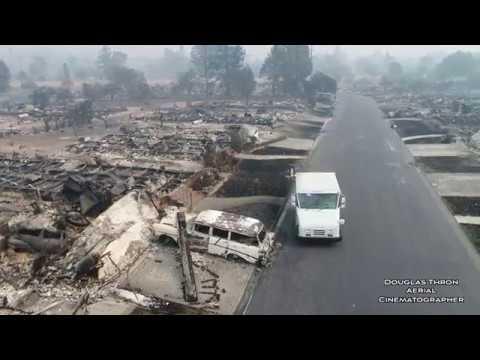 USPS Postman Delivers Mail to Santa Rosa burned homes