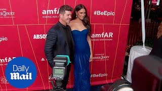 Robin Thicke & a pregnant April Love Geary at the amFar Gala