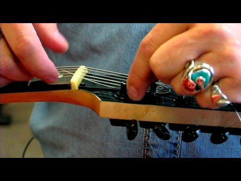 electric guitars how to change electric guitar strings youtube. Black Bedroom Furniture Sets. Home Design Ideas