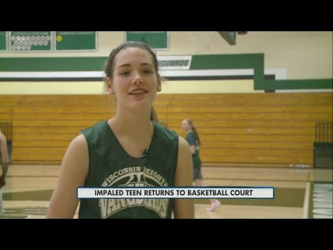 Impaled teen returns to basketball court