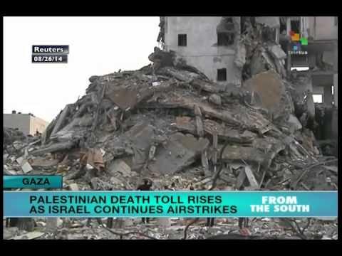 Israeli air strikes destoy 13 story residential building in Gaza