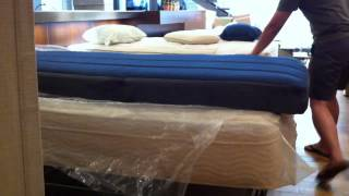 Unpacking Keetsa Twin Xl Mattress With Denim Fabric.