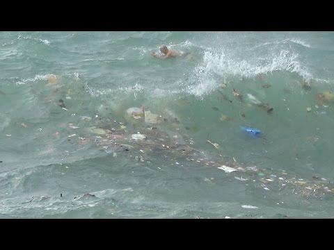 Ballsy Typhoon Swimmers in Hong Kong Harbour During Kalmaegi
