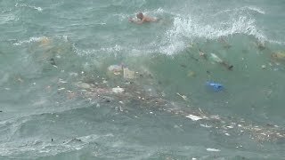 Ballsy Typhoon Swimmers in Hong Kong Harbour During Kalmaegi thumbnail