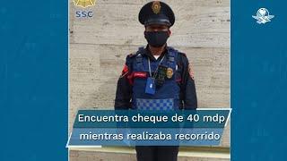 El elemento de la Policía Bancaria e Industrial encontró el cheque frente a la entrada del estacionamiento de un complejo de departamentos en la colonia Polanco