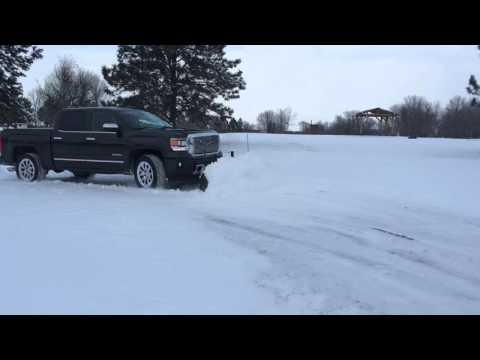2014 GMC Denali 1500 plowing snow with SNOWSPORT® HD Utility Plow