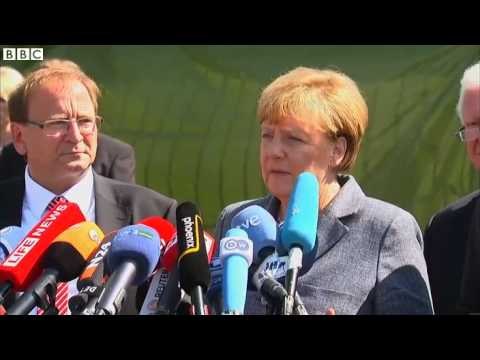 Germany's Angela Merkel booed at migrant centre