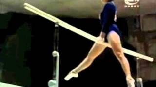 1960 Olympics: Sofia Muratova (URS) Bars