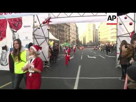 Thousands dress up as Santa for annual charity run through capital