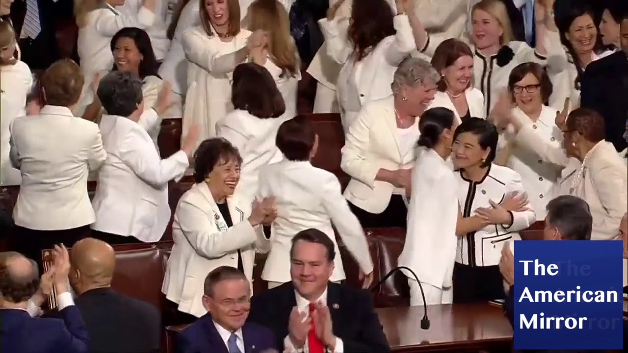 Alexandria Ocasio-Cortez high-fives the air during Trump State of the Union