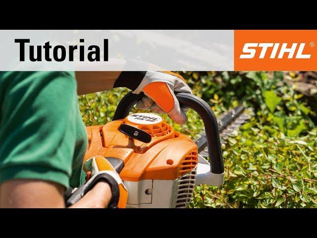 Refuelling a STIHL petrol hedge trimmer