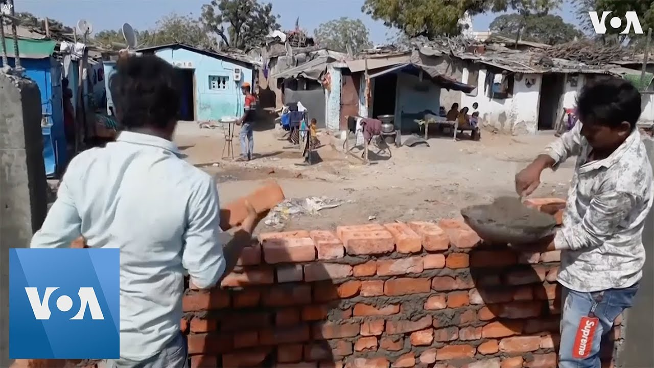 Download India Builds Wall Hiding Slum Ahead of Trump Visit