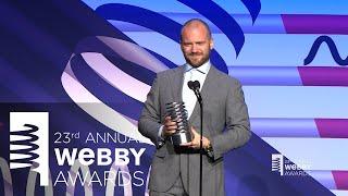 Adam Richman presents to Webby Winner Sean Evans of Hot Ones