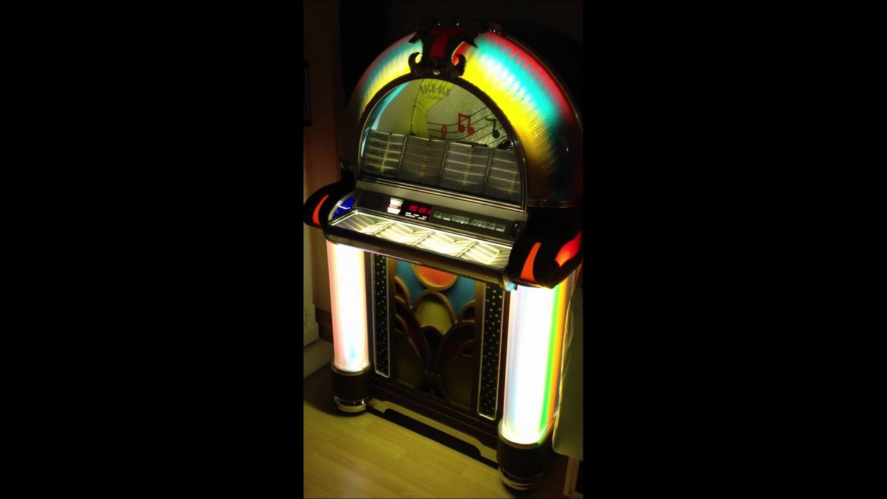 ROCK OLA 1000 JUKEBOX FULL RESTORED PLAYING PUPPET ON A STRING