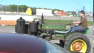 Wood Gas Tractor Project. My Son Driving The John Deere On Wood